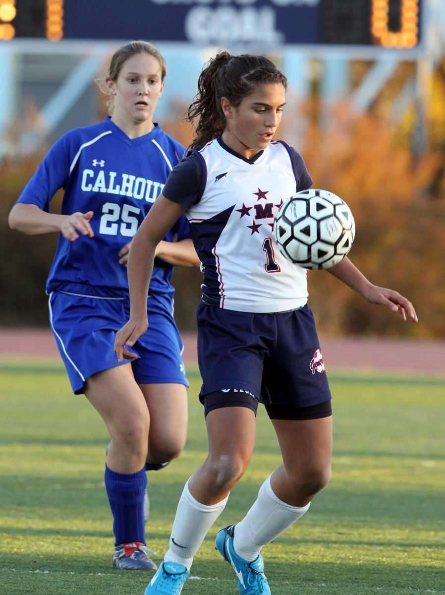 MacArthur's Arianna Montefusco keeps ball in front during
