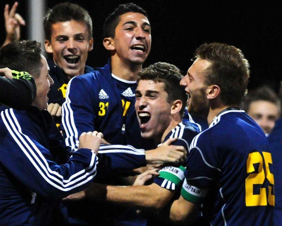 Jericho High School players react after a goal
