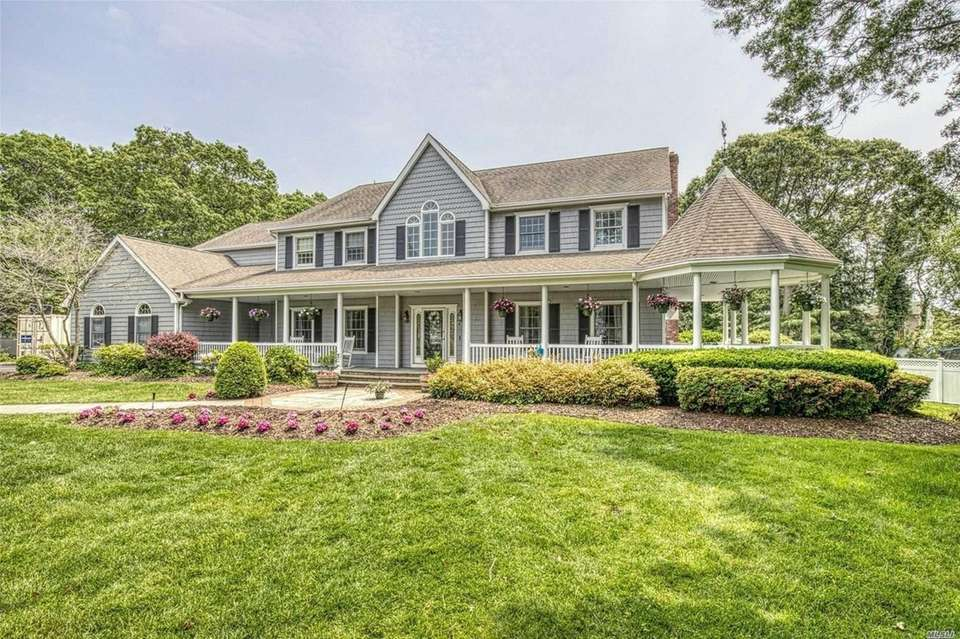 This Sayville Victorian has four bedrooms, three bathrooms