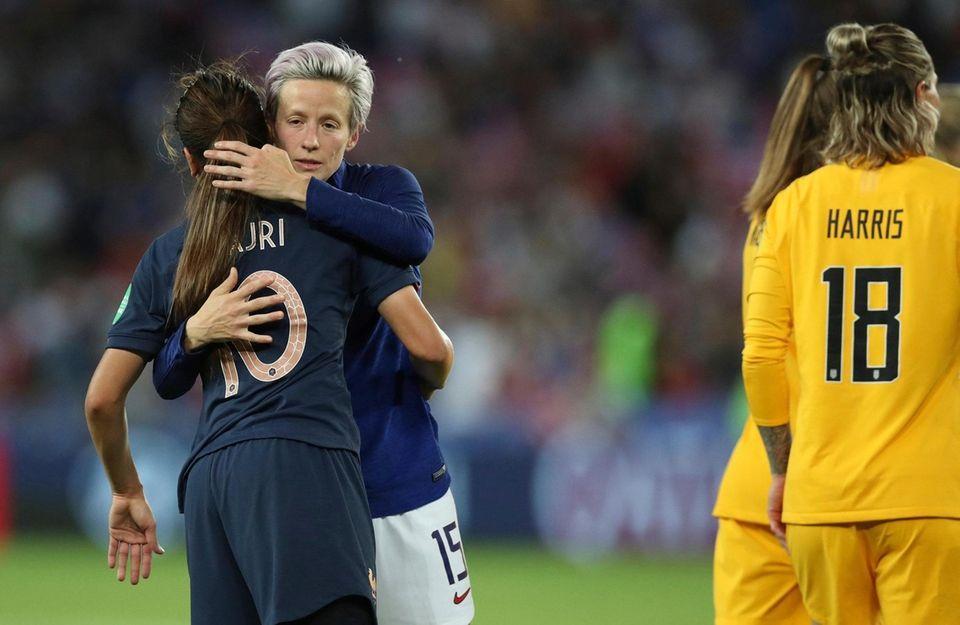 United States' Megan Rapinoe, second left, embraces France's