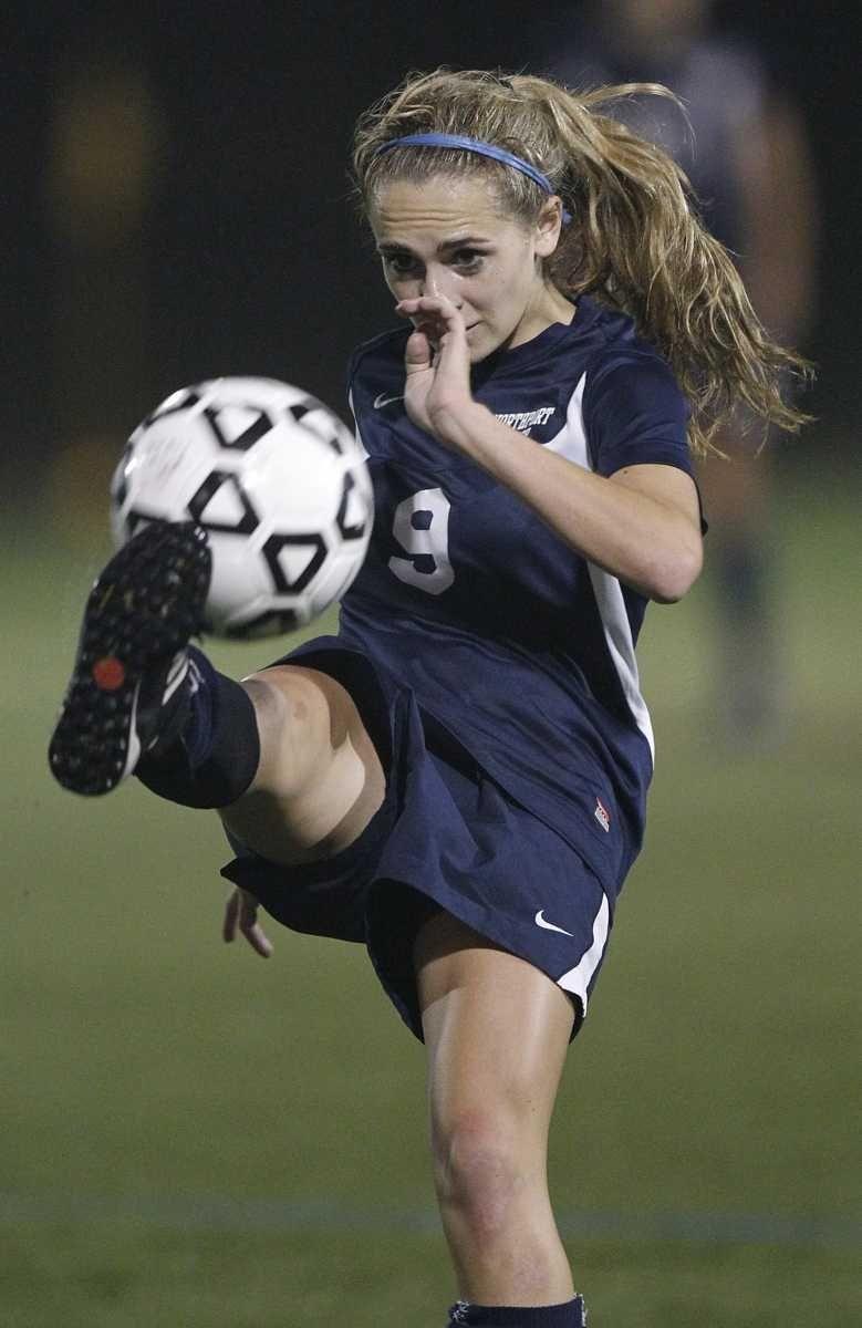 Northport's Kristi Abbate (9) advances the ball with