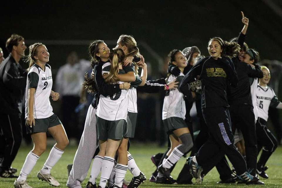 Ward Melville teammates celebrate their 1-0 victory over