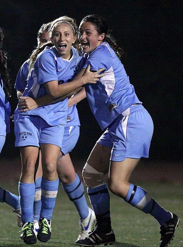 South Side's Christina Klaum (left) celebrates after scoring