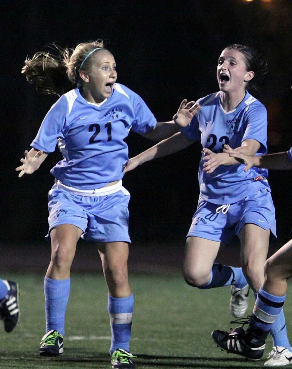 South Side's Christina Klaum (left) celebrates with teammate