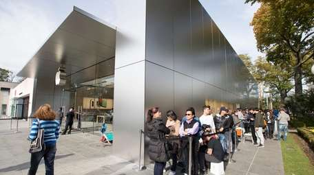 Shoppers in Manhasset wait to purchase the newest
