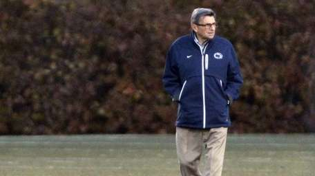 Penn State coach Joe Paterno looks on during