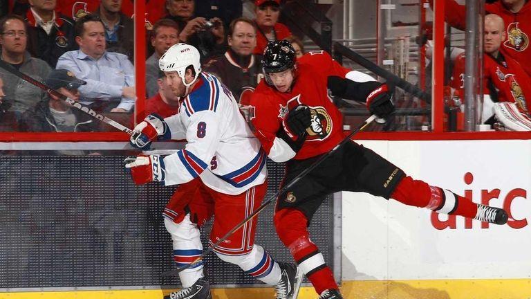 David Rundblad #7 of the Ottawa Senators checks