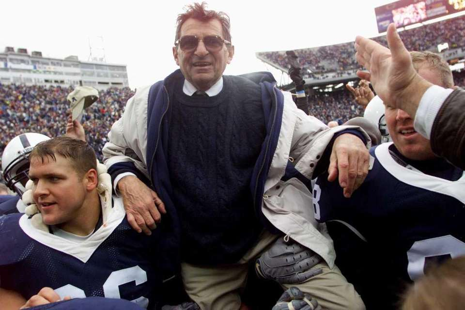 Penn State head coach Joe Paterno is celebrated