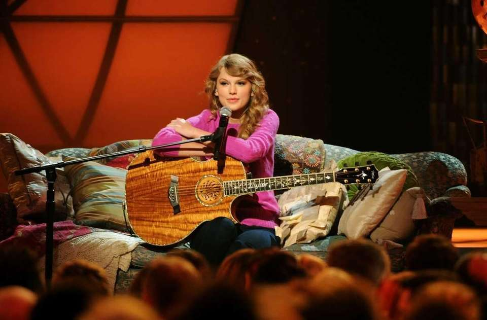 Taylor Swift performs at the 45th annual CMA