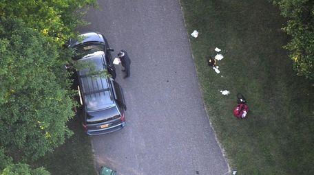 Crime scene investigators on Thursday inspect the minivan