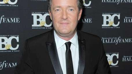 Piers Morgan poses for a photo at the