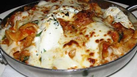 Pan-baked lasagna, here with veal sausage, is cooked