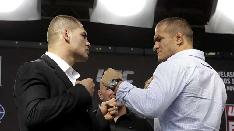 Mixed martial arts fighters Cain Velasquez, left, and
