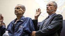 Retired NYPD Det. Luis Alvarez with Jon Stewart