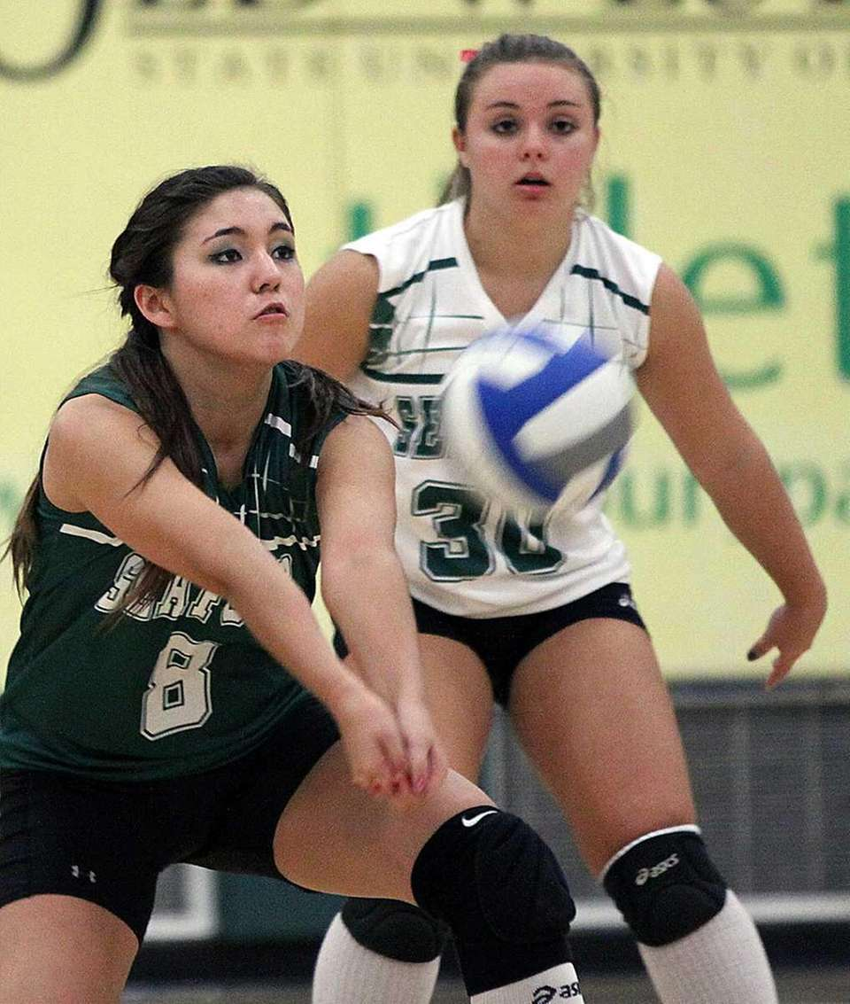 Seaford's Zulfiya Asquino digs the ball with teammate