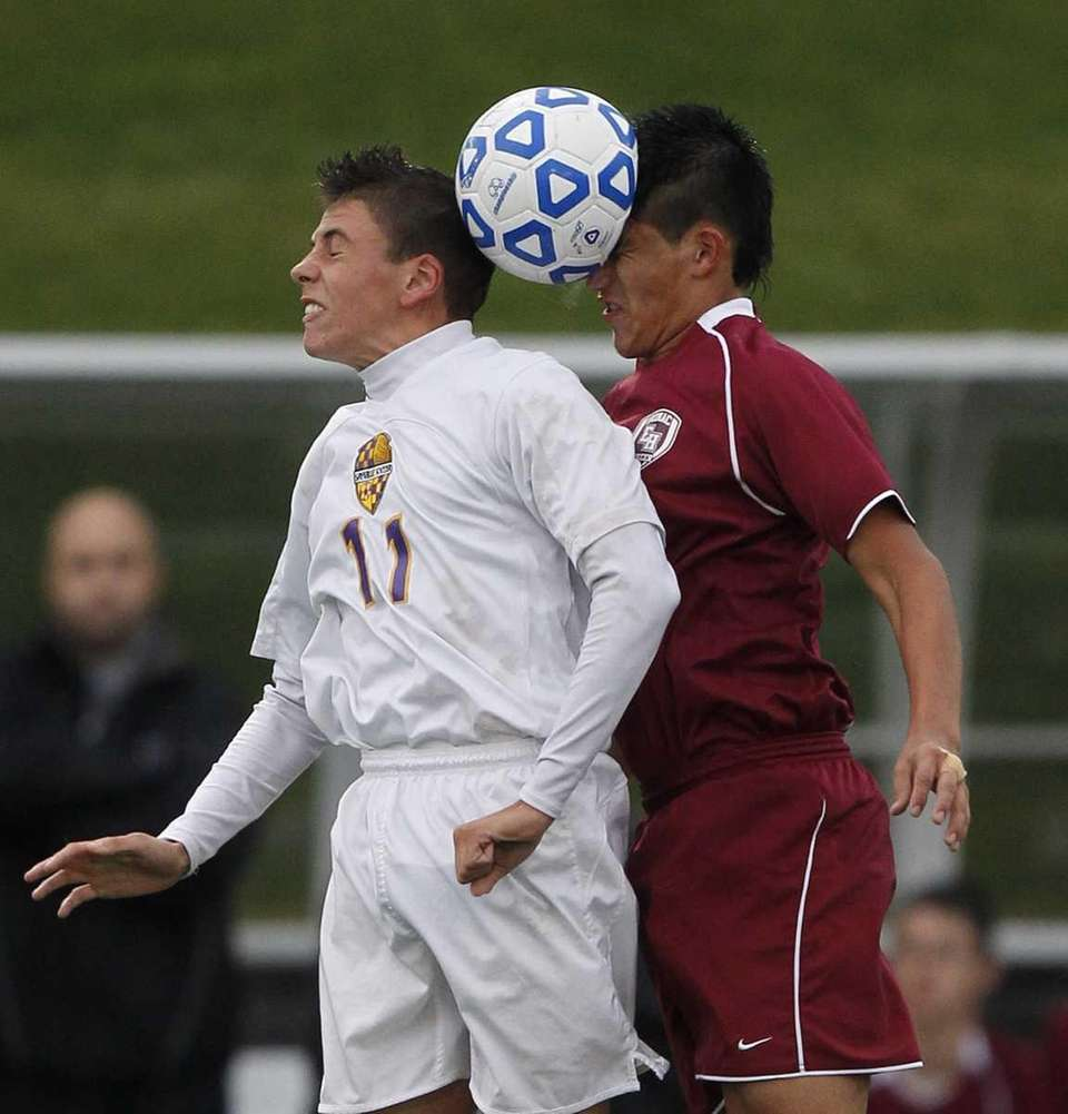 Sayville's Chris Siracusa (11) goes for the header