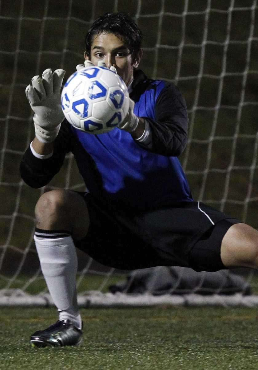 East Hampton keeper Esteban Aguilar with the save