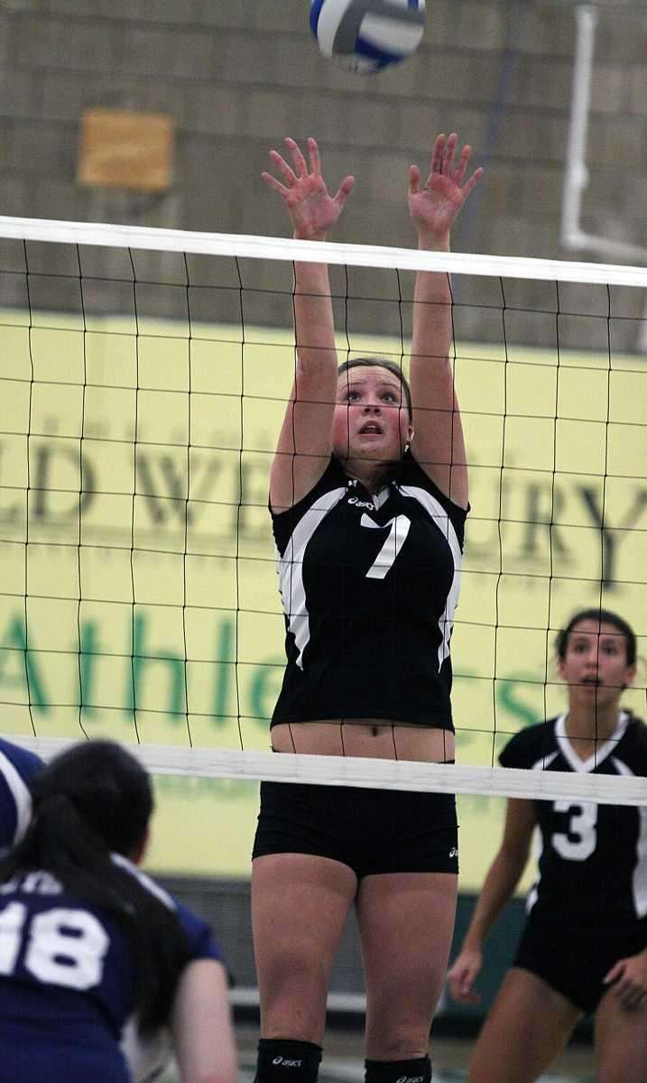 Wantagh's Lauren Pennino for the block during the