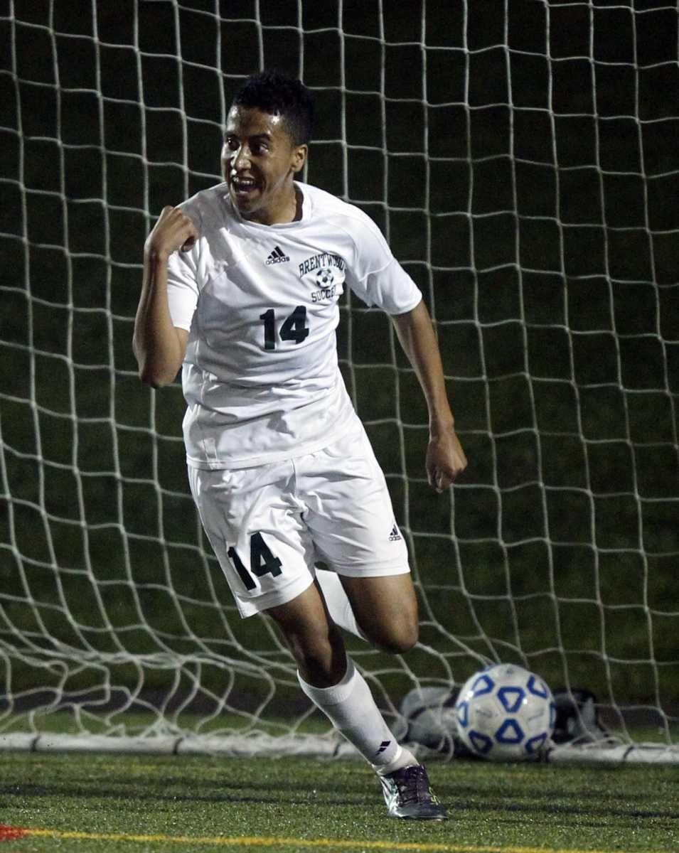 Brentwood's Andrew Ortega (14) celebrates the opening score