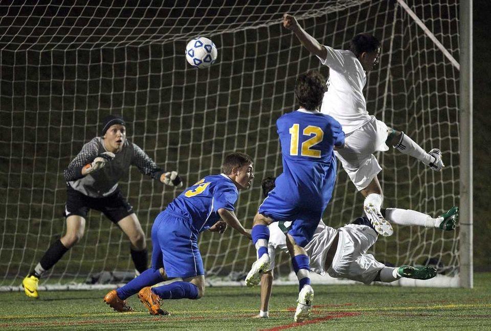 Brentwood's Kervin Martinez's (8) shot on goal off