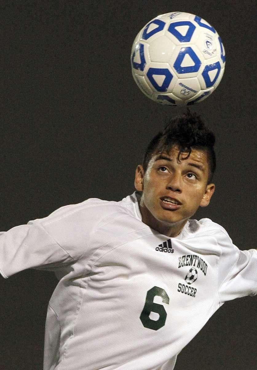 Brentwood's Ever Torres (6) heads the ball in