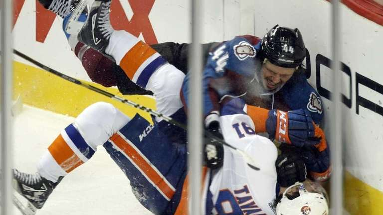 Colorado Avalanche's Ryan Wilson (44) slams New York