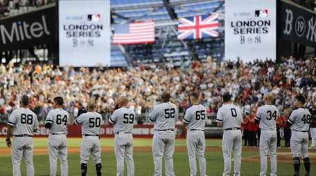 New York Yankees players wait for the start