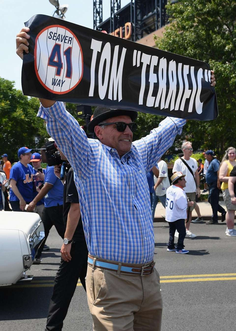 A fan holds a sign for Tom Seaver
