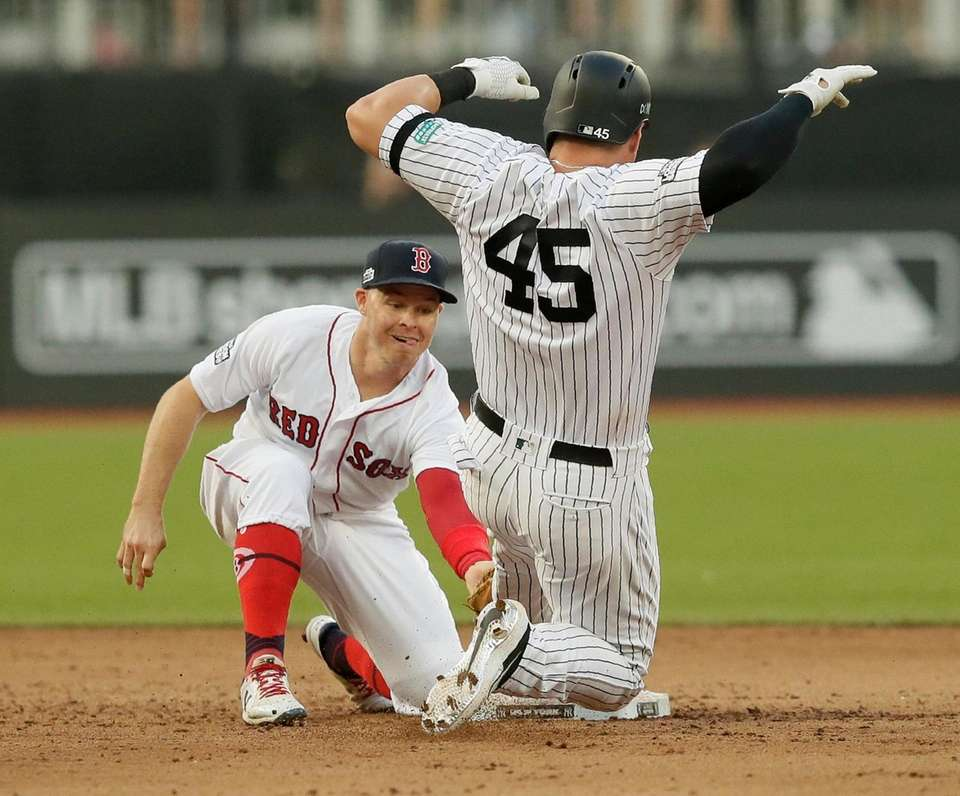 New York Yankees' Luke Voit slides safely into