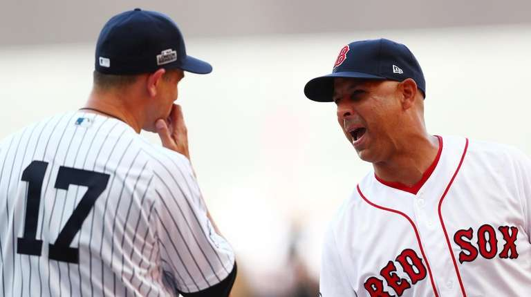Yankees manager Aaron Boone speaks with Red Sox
