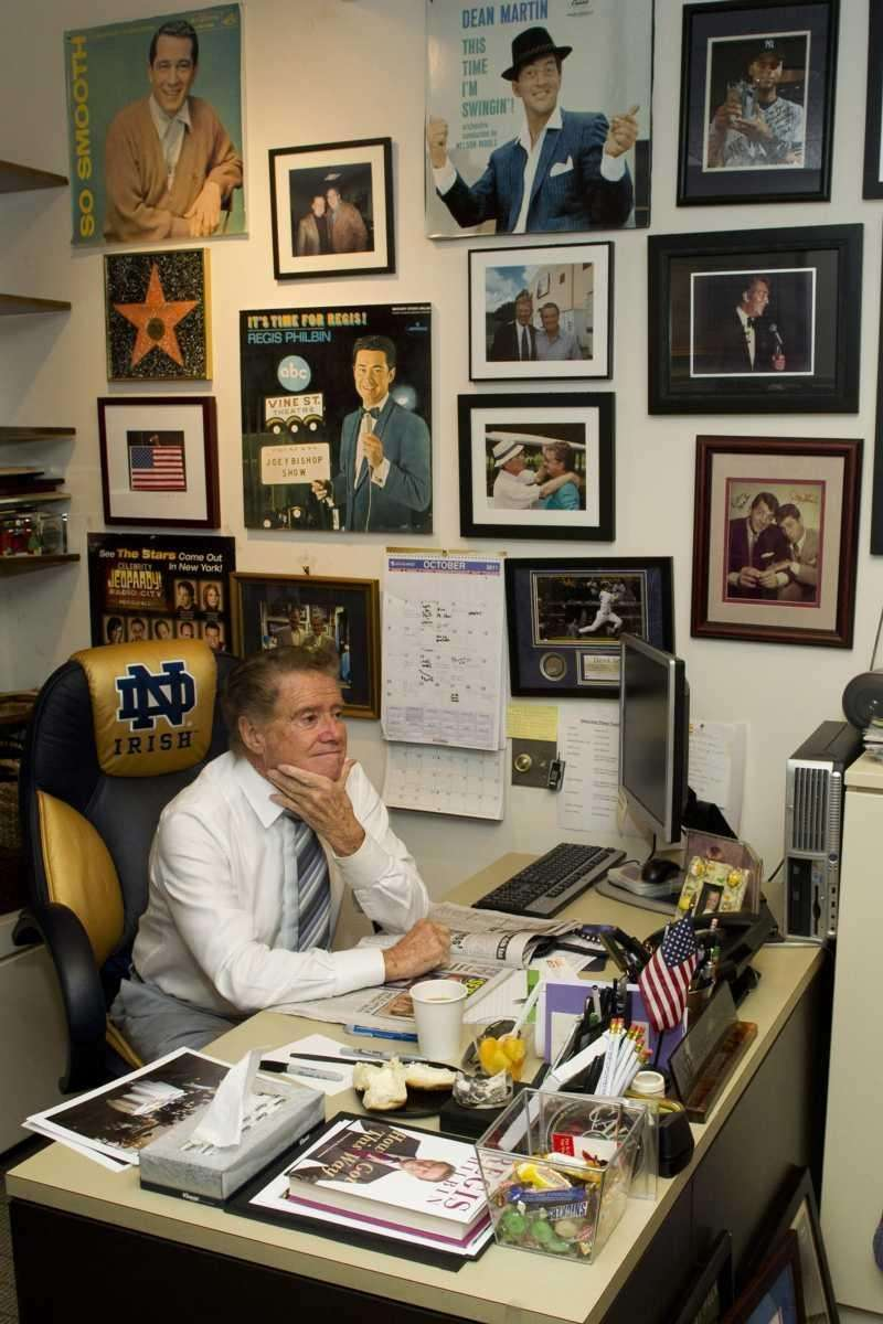 Regis Philbin reads a newspaper in his office