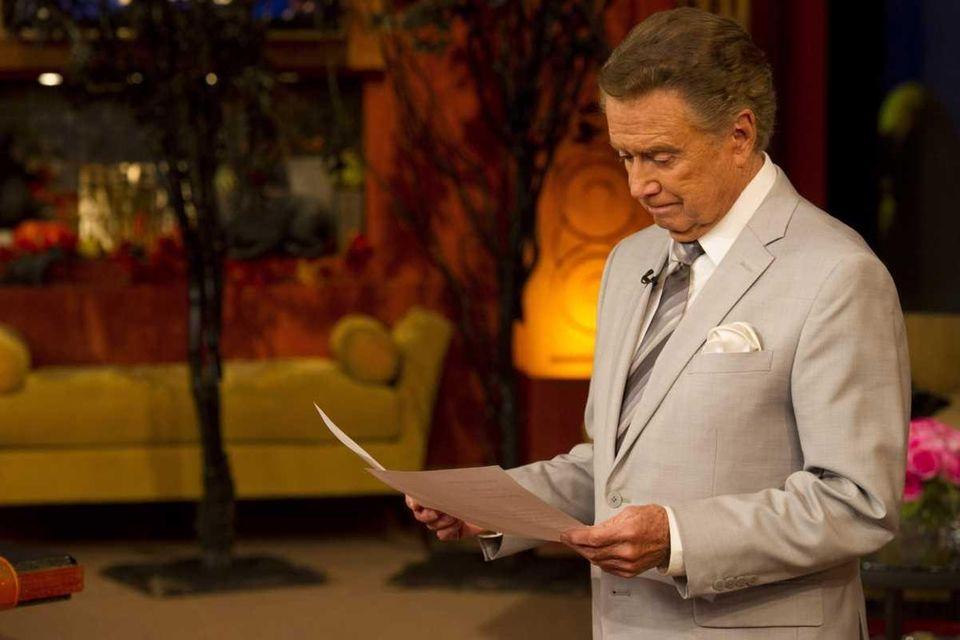 Talk show host Regis Philbin goes over his