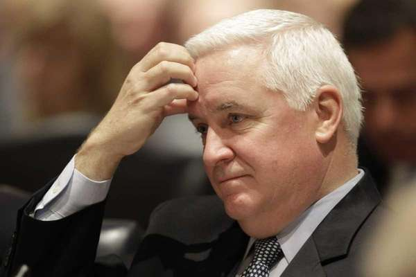 Pennsylvania Gov. Tom Corbett listens during a meeting