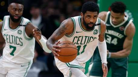Boston Celtics' Kyrie Irving brings the ball up