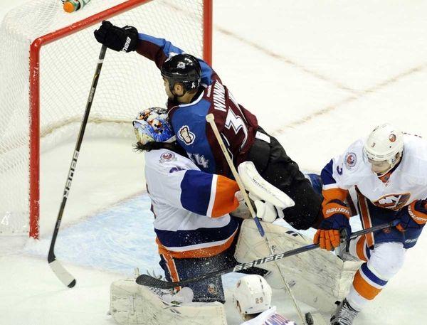 Colorado wing Daniel Winnik crashed into Islanders goalie