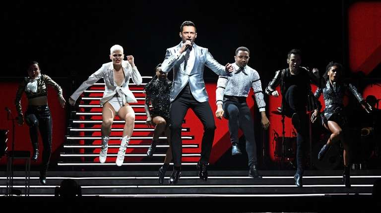Hugh Jackman performs onstage during his show at