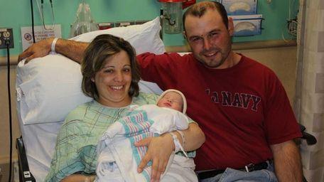 Rosa Martins, Paulo Martins and baby Olivia, a