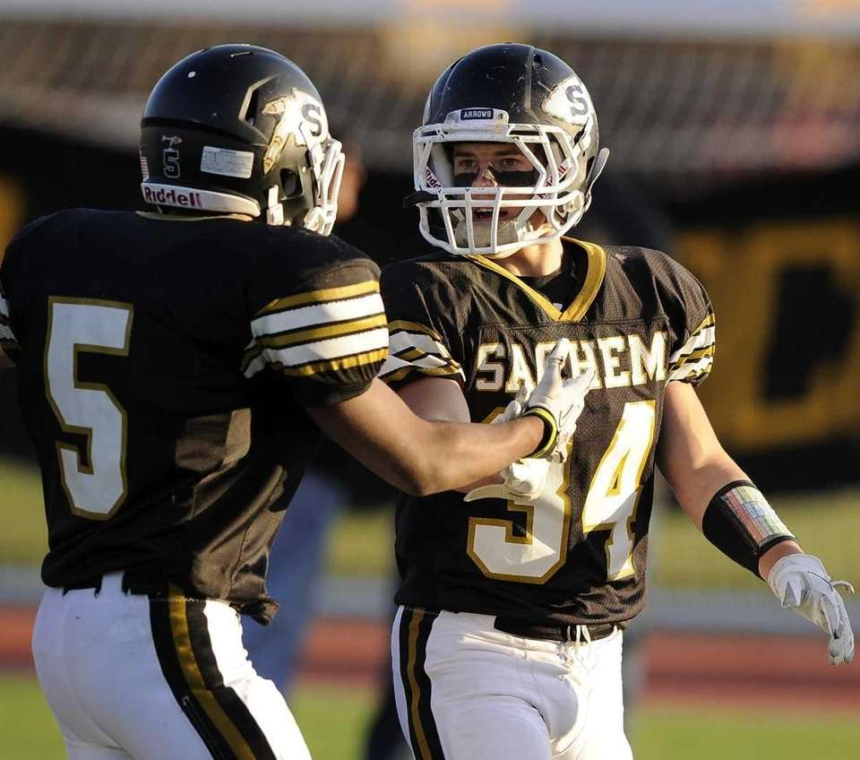 Sachem North's Mailk Pierre, left, congratulates Dalton Crossan,
