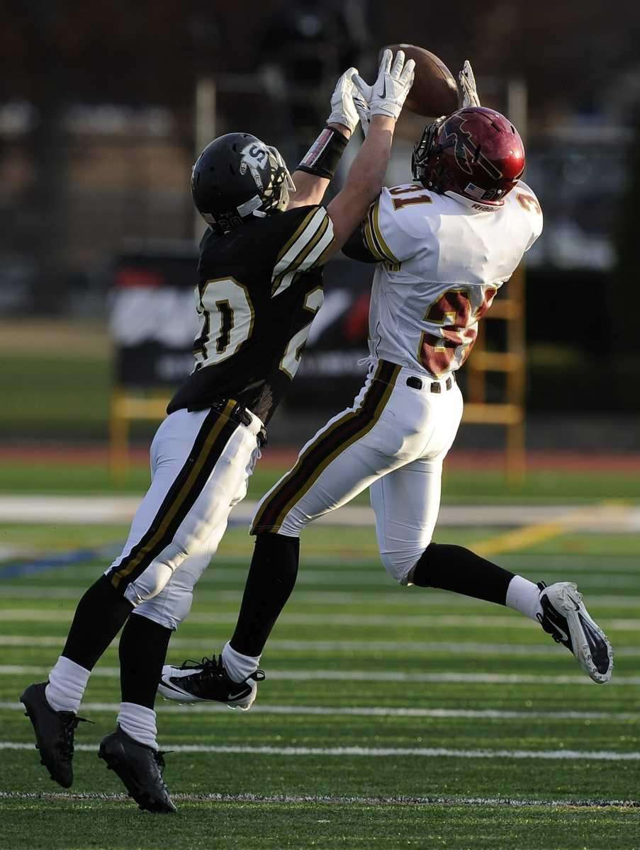 Sachem East's #31 catches the football under pressure