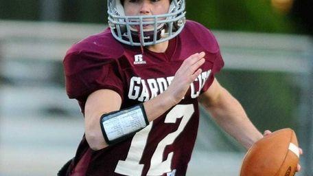 Garden City High School quarterback #12 Mike Comiskey