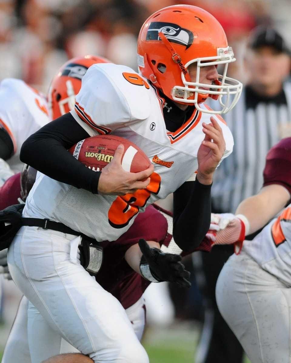 Carey High School quarterback #6 Andrew Ris runs