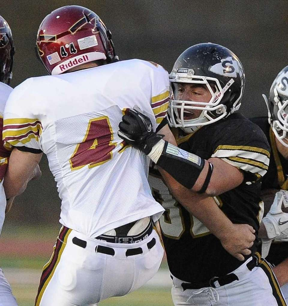 Sachem North's Tyler Andreassi, right, tackles Sachem East's