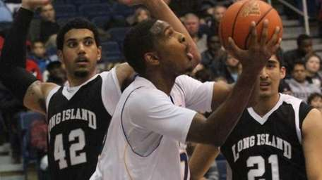 Hofstra's #23 Mike Moore drives to the net