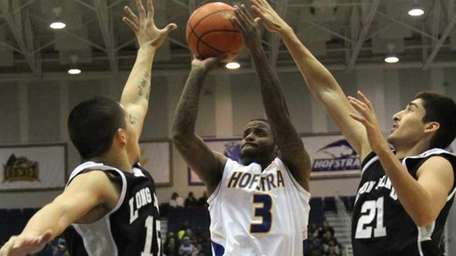 Hofstra's #3 Steve Mejia shoots for two points