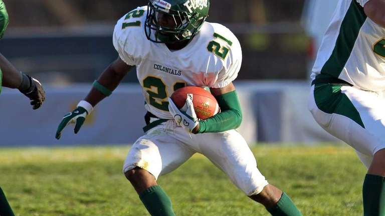 Floyd RB Stacey Bedell #21, cuts back through