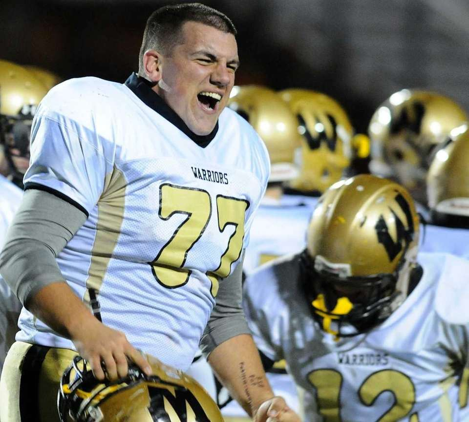 Wantagh High School lineman #77 Stephen English reacts