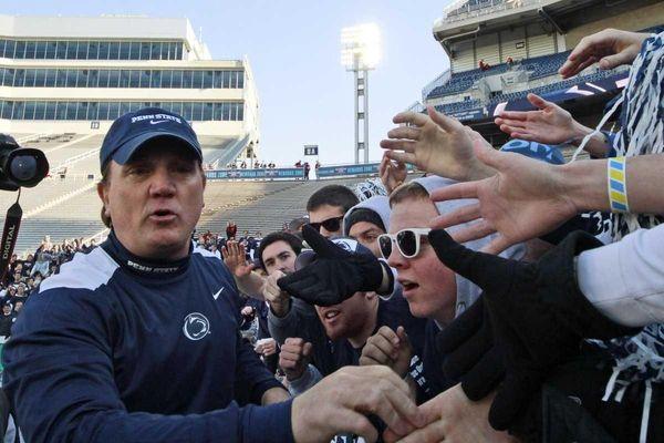 Penn State interim head coach Tom Bradley greets