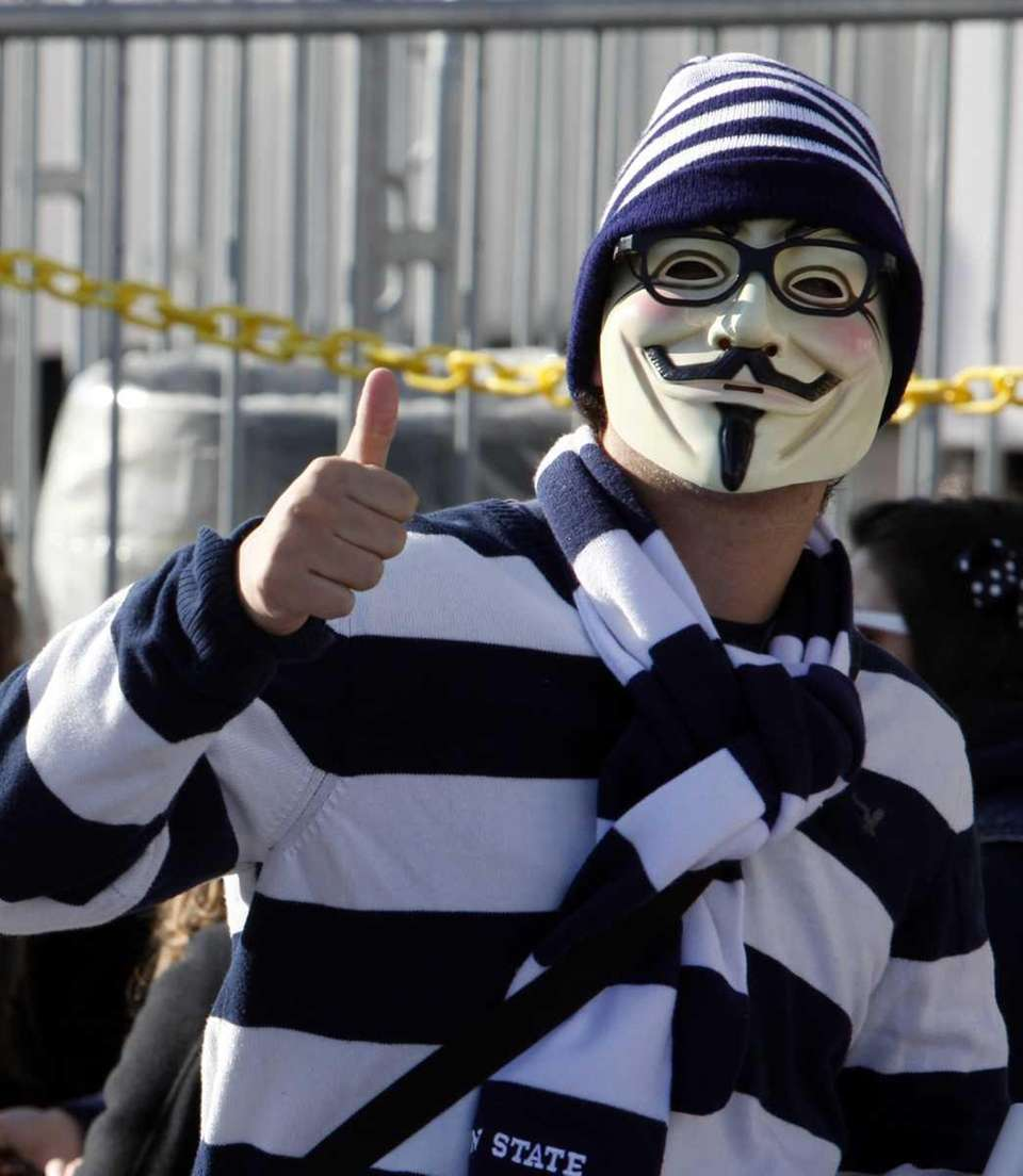A student wears a mask and Joe Paterno