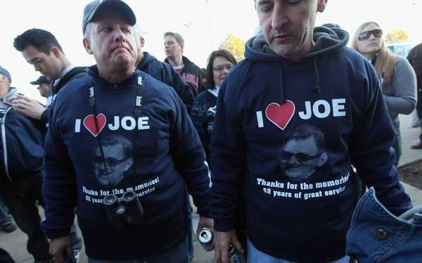 Penn State fans wear shirts supporting Joe Paterno