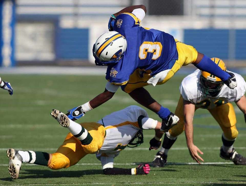 Lawrence HS #3 Tyler Fredericks leaps over a